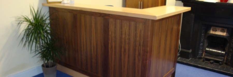Reception desk, custom design and built from walnut and maple